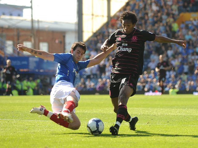 Portsmouth's Marc Wilson (left) and Everton's Jo (right) in action