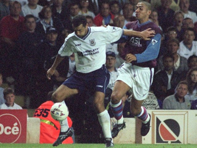 Aston Villa's Stan Collymore (right) is held at bay by Tottenham Hotspur's Colin Calderwood