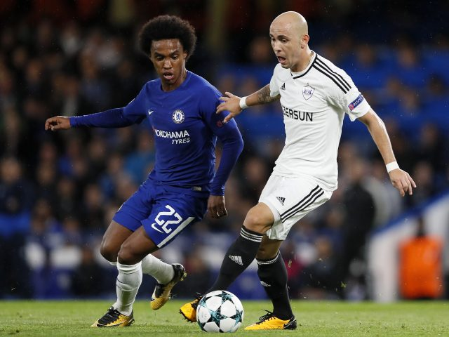 Richard Almeida, right, challenges for the ball with Chelsea's Willian during the Champions League group C match at Chelsea
