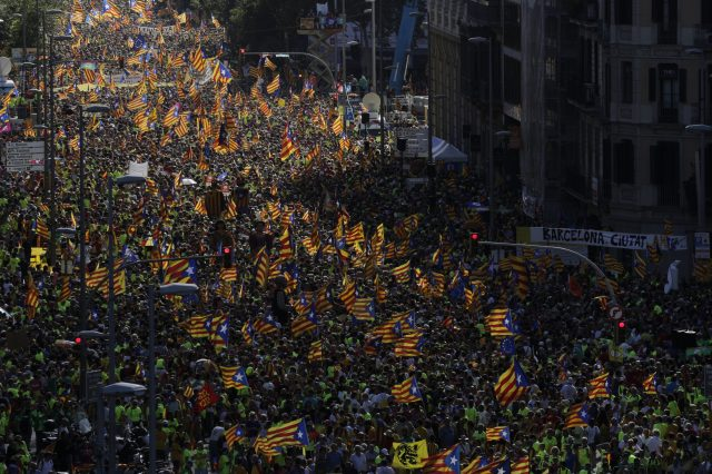 Catalans with independence flags gather during the Catalan National Day in Barcelona, Spain