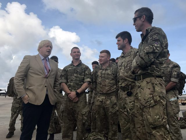 Boris Johnson talks to Royal Marines in Barbados