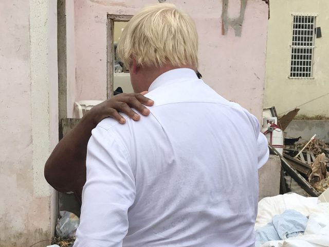 Dorothy Nibbs is comforted by Boris Johnson