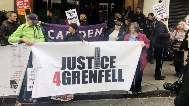 Protesters outside the Grenfell Tower public inquiry in central London where Sir Martin Moore-Bick is delivered his opening statement