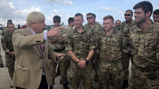 Boris Johnson talks to Royal Marines from 40 Commando in Barbados ravaged by Hurricane Irma