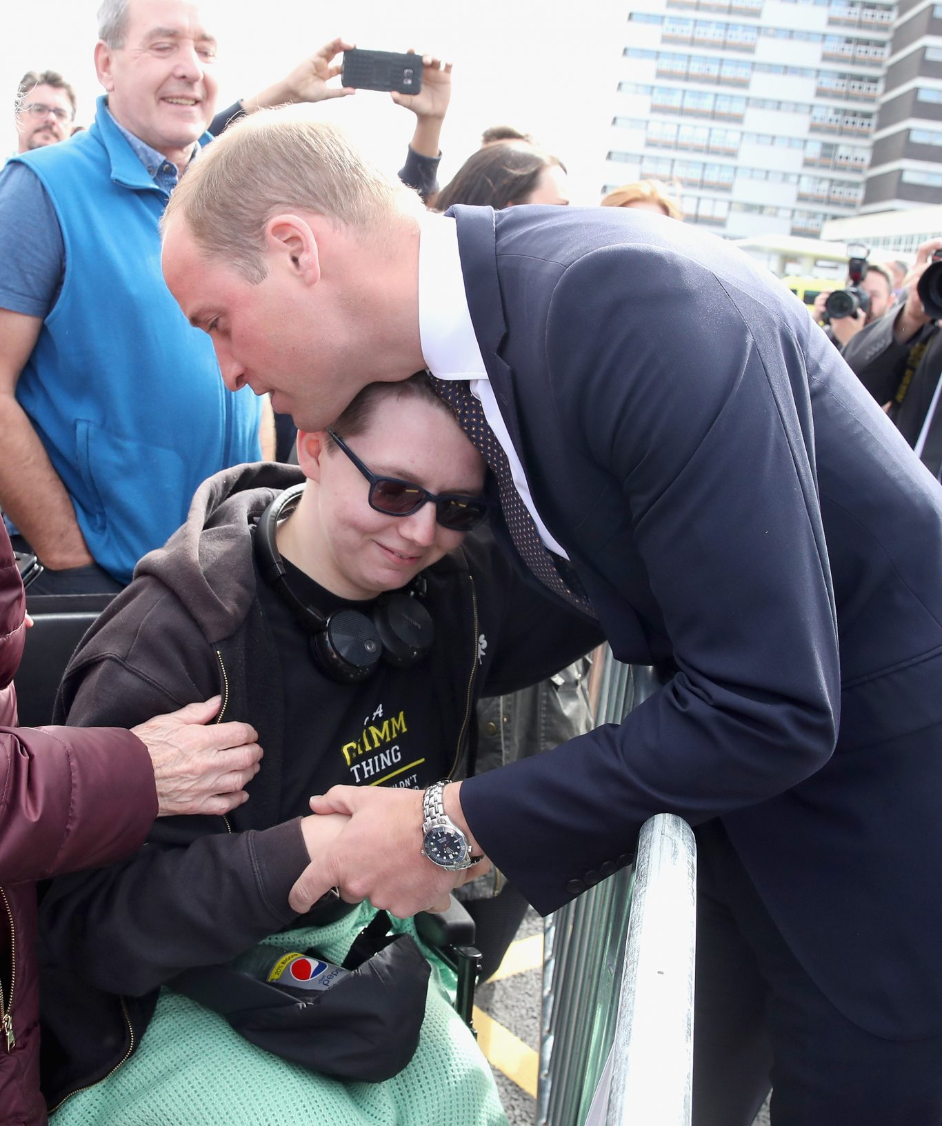 The Duke of Cambridge hugs Katie Daley (Chris Jackson/PA)