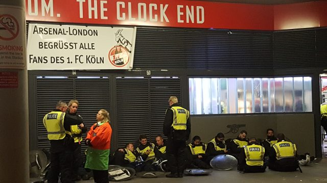 Police officers take a break outside the Emirates Stadium