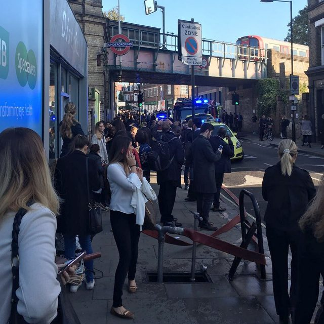 People watch as the emergency services deal with an explosion at Parsons Green