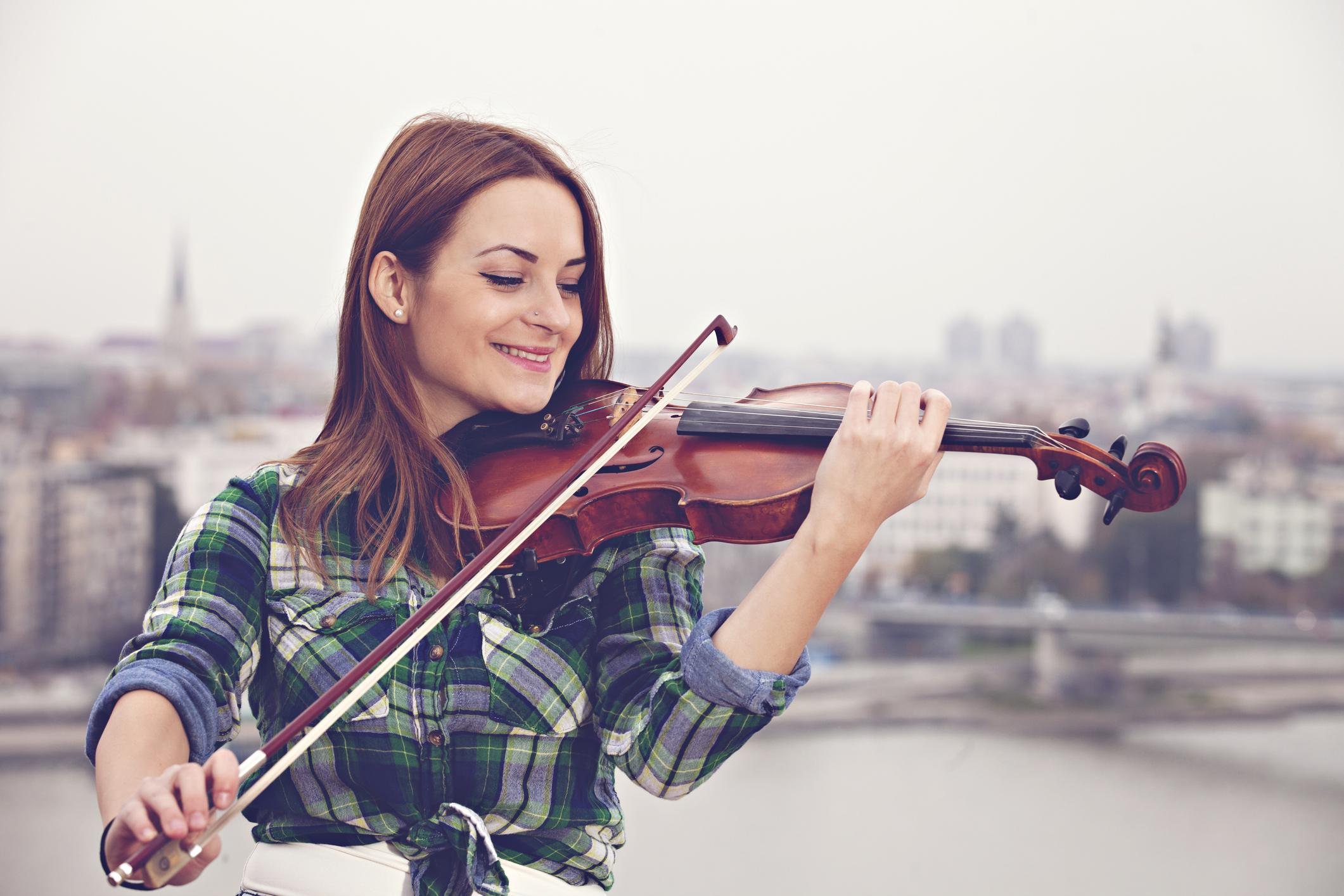 Woman playing violin outdoors (Thinkstock/PA)