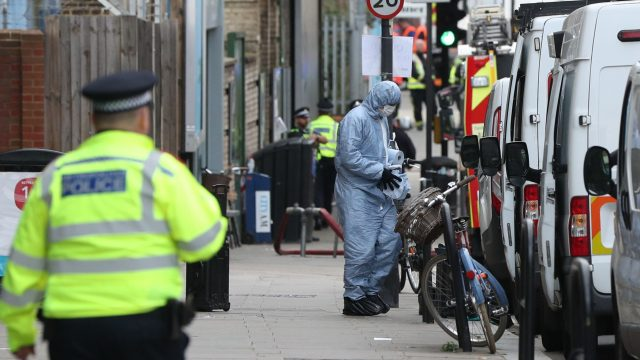 A forensic officer outside Parsons Green station in west London as a manhunt has been launched after a bomb was detonated in a terror attack on a packed London Underground train (Jonathan Brady/PA)
