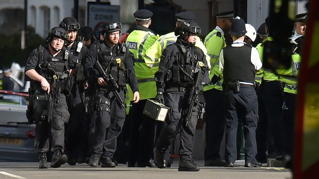 Armed police close to Parsons Green station in west London after an explosion on a packed London Underground train