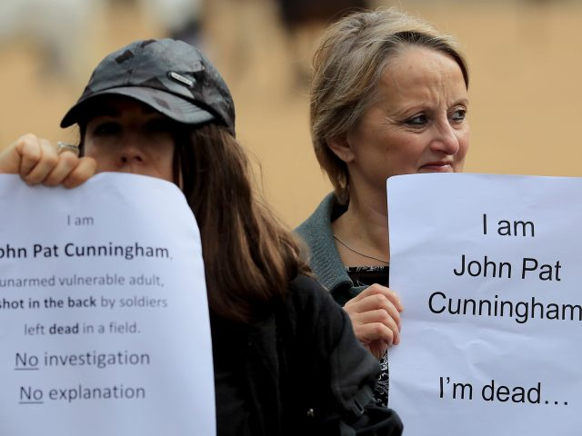 Supporters of John Pat Cunningham hold a counter protest