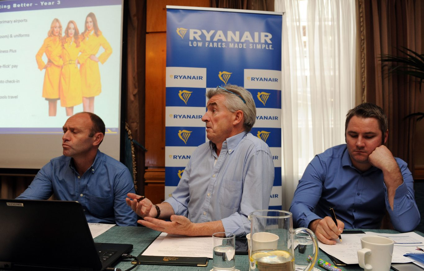 Ryanair's operations manager Robin Kiely, right, with chief executive Michael O'Leary, centre, and chief marketing officer Kenny Jacobs (Nick Ansell/PA)