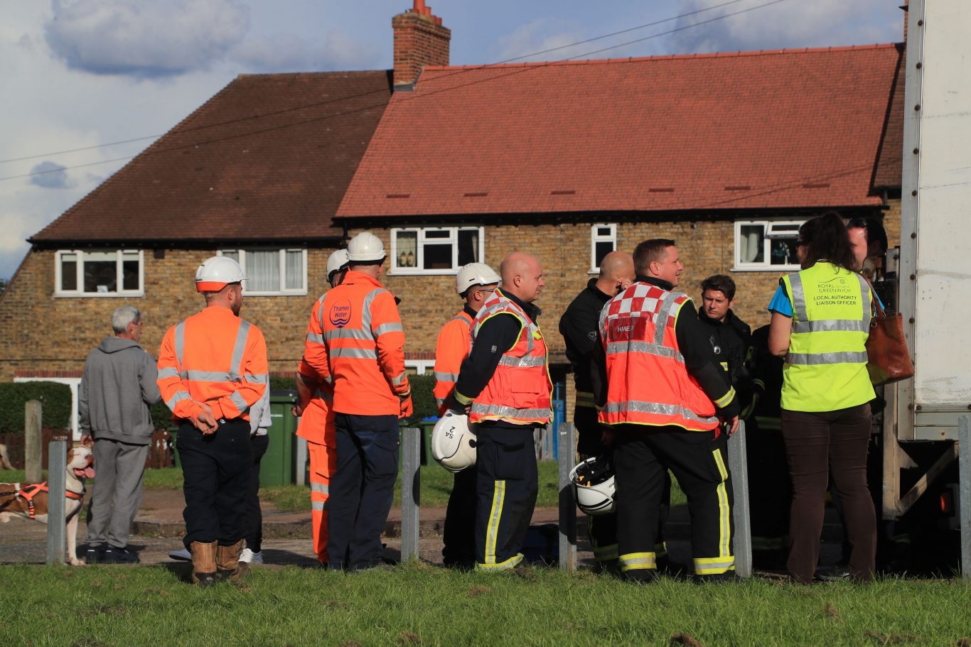 Emergency services personnel and staff from Thames Water and the local authority of Greenwich at Alwold Crescent in Lee, south London, where residents were rushed to hospital with nausea and vomiting amid fears of a chemical incident (Gareth Fuller/PA)