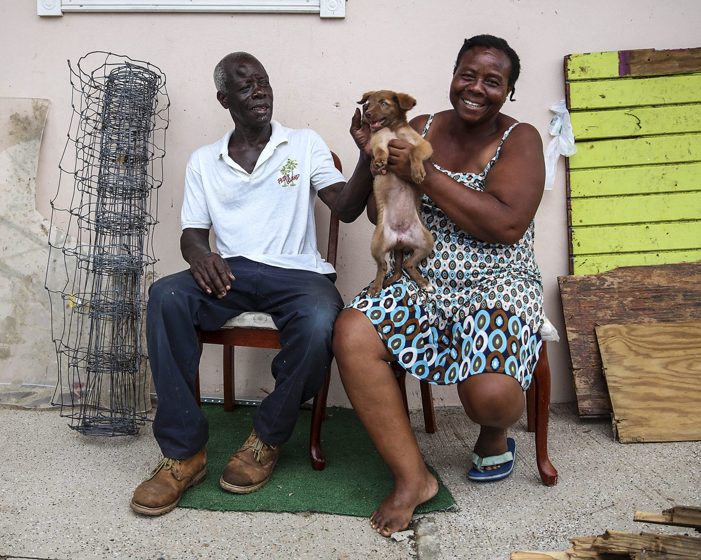 Alvin and Dorothy Nibbs with their 11-week-old puppy, Lilly, in Road Town, Tortola (Ministry of Defence/PA)