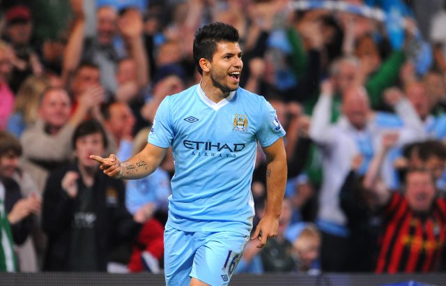 Aguero celebrates scoring his second and his side's third against Swansea(Joe Giddens/Empics)