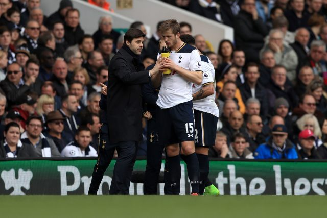 Eric Dier gets instructions from Mauricio Pochettino