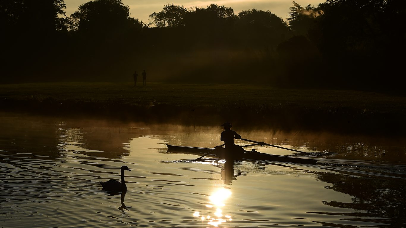 Rowers train as the sun rises over the River Cam in Cambridge on the day of the Autumn Equinox (Joe Giddens/PA)