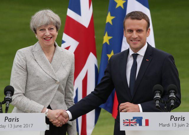Mrs May and Mr Macron. (Yui Mok/PA)