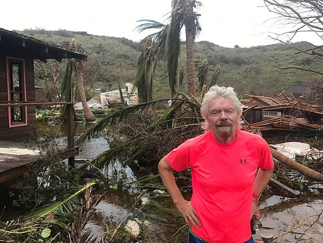 Sir Richard Branson amongst the debris on his private island Necker caused by Hurricane Irma. (Virgin.com/PA)