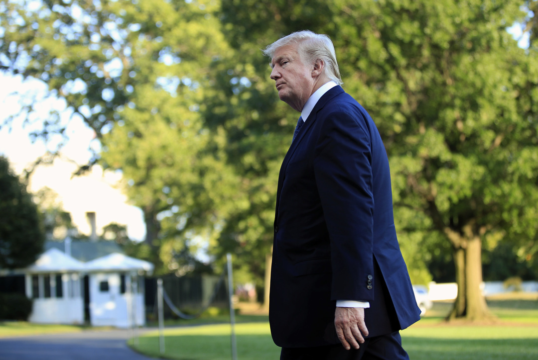 President Donald Trump walks towards the White House in Washington