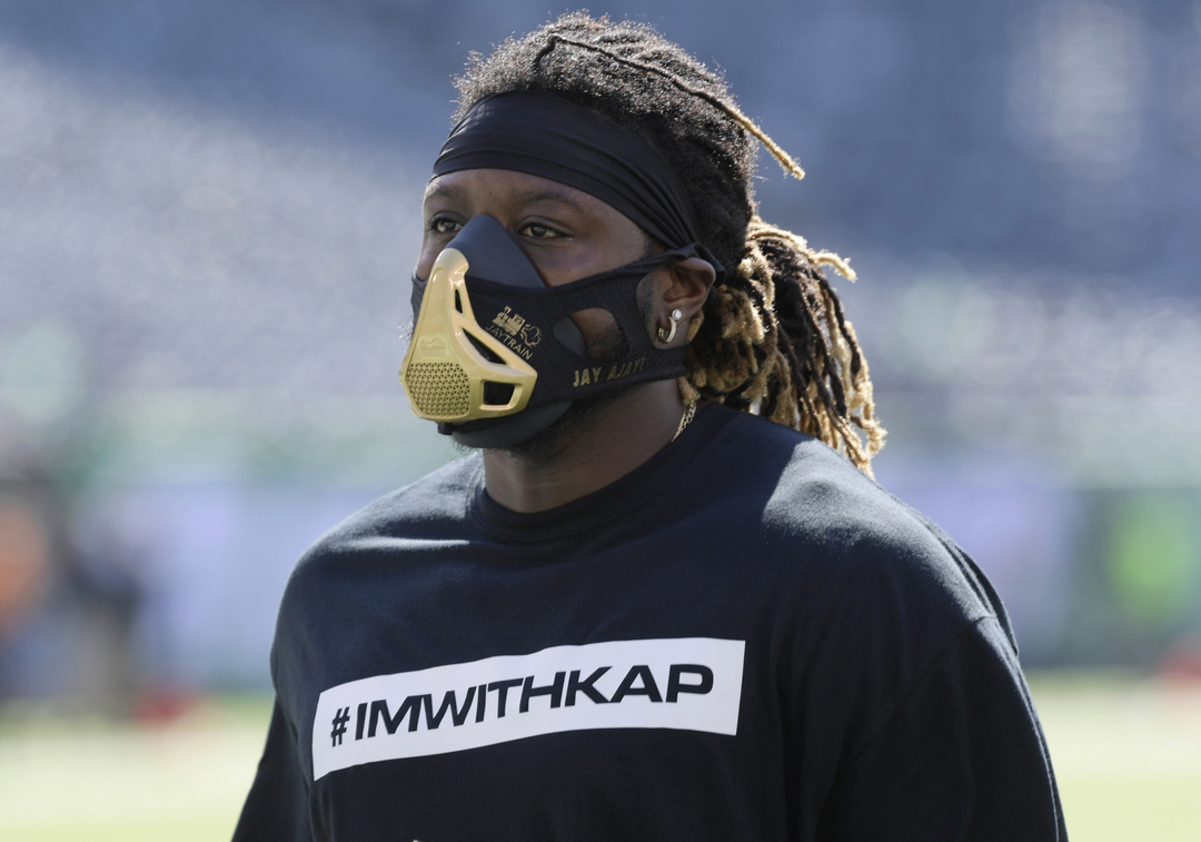 Miami Dolphins running back Jay Ajayi warms up in a #imwithkap shirt on Sunday (Bill Kostroun/AP)