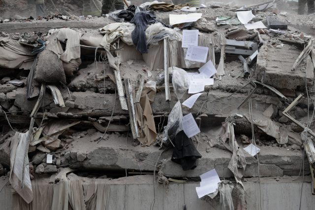 Documents tumble down past collapsed floors of a building in Mexico City