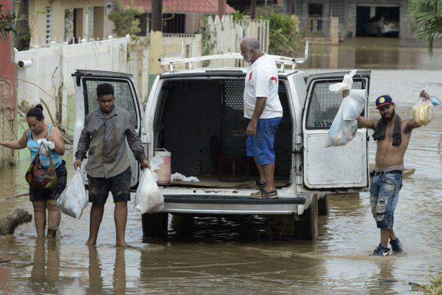 Residents after Hurricane Maria hit Puerto Rico. ( Carlos Giusti/AP/PA)