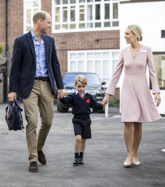 Prince George holding hands with the Duke of Cambridge and Helen Haslem, head of the lower school. (Richard Pohle/The Times/PA)