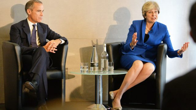 Mark Carney with the the Prime Minister Theresa May as she answers an audience question, at the Bank of England 'Independence 20 years on' conference
