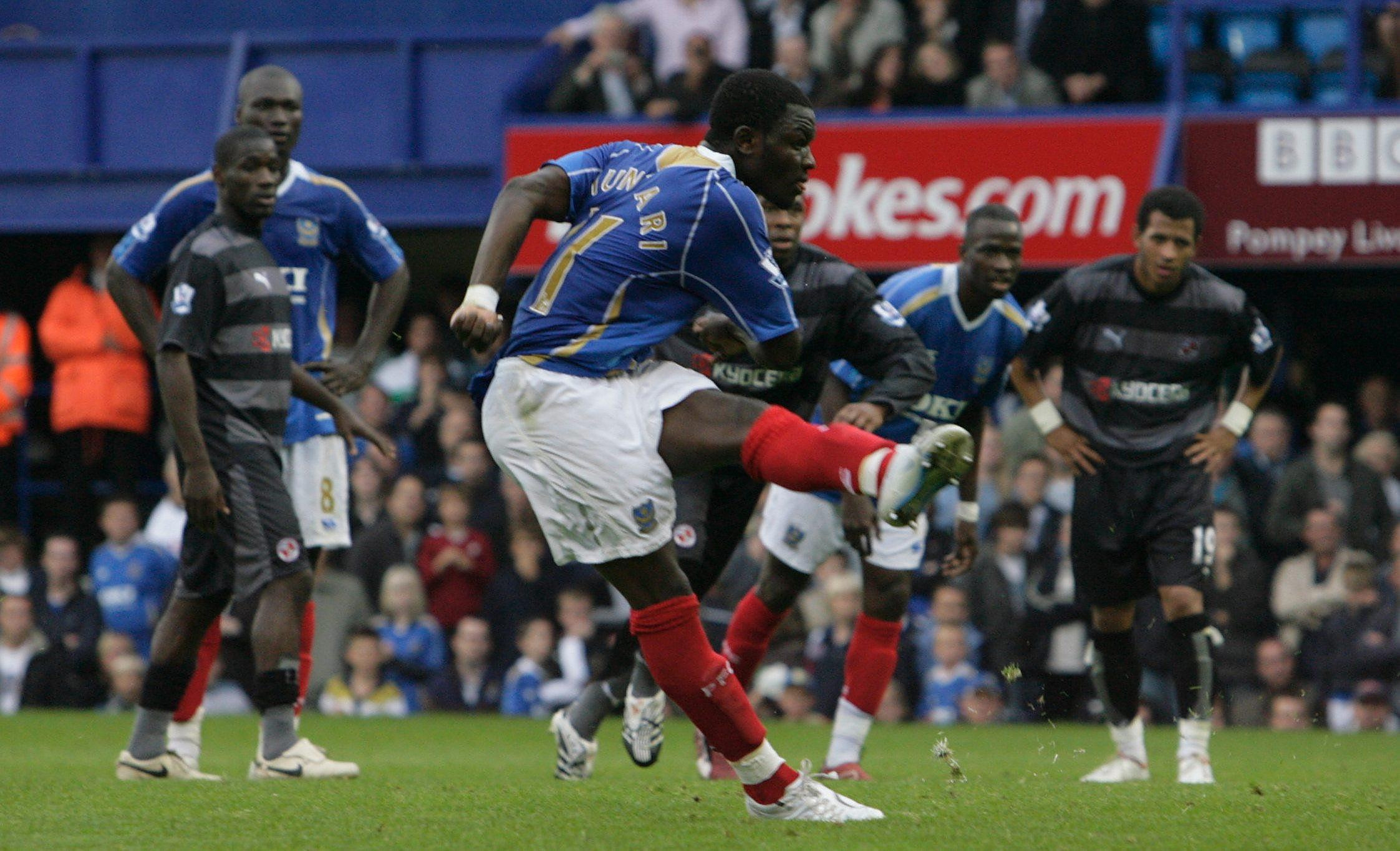 Sulley Muntari takes a penalty for Portsmouth against Reading