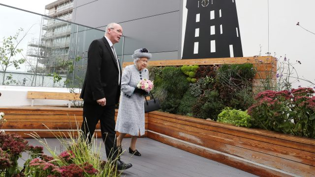 Reverend James Falconer shows Queen Elizabeth II the Robertson Family Roof Garden during a visit to Aberdeen Royal Infirmary