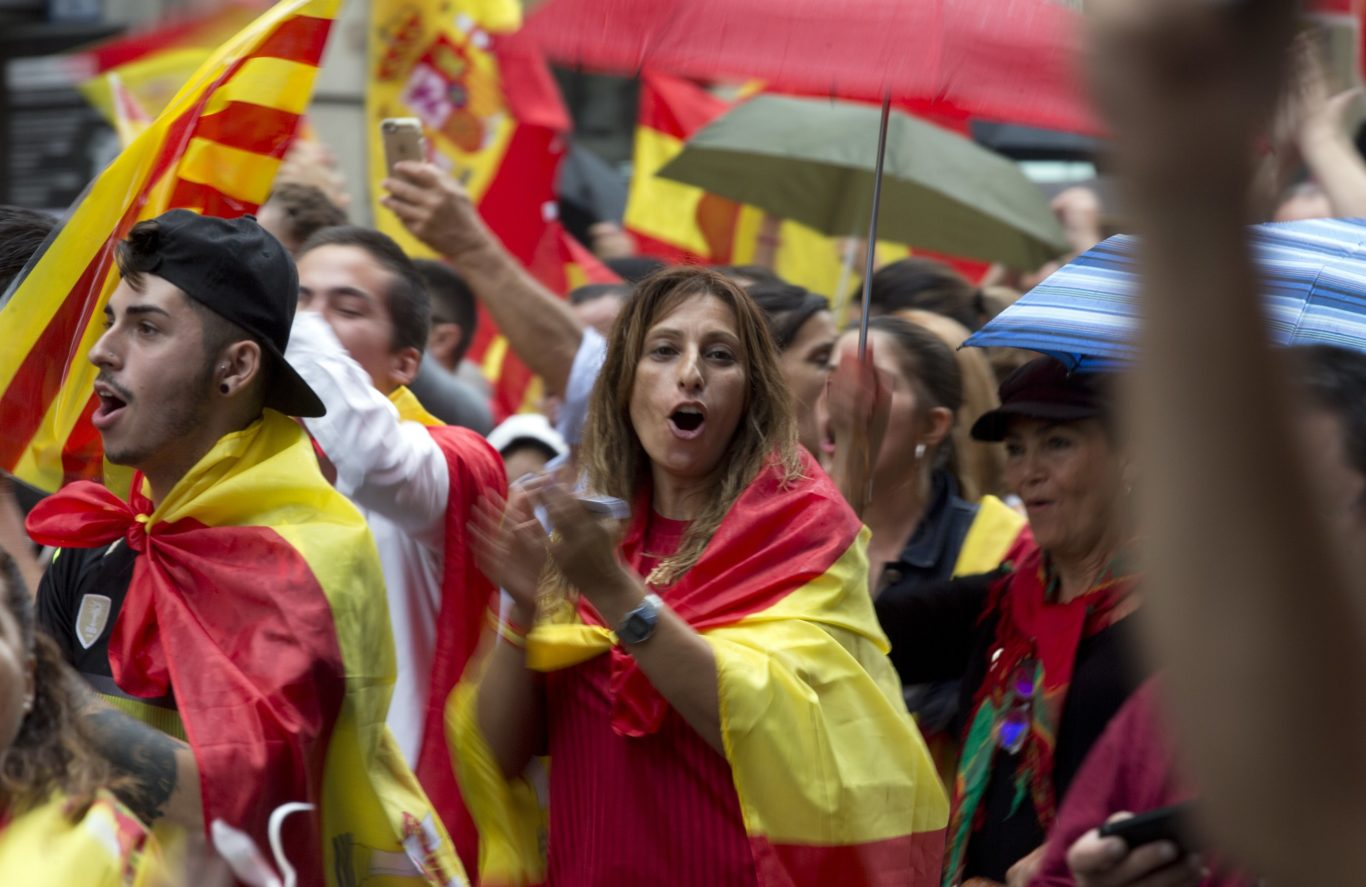 Pro-Spanish unity demonstrators march in downtown Barcelona on Sunday (Enric Marti/AP)