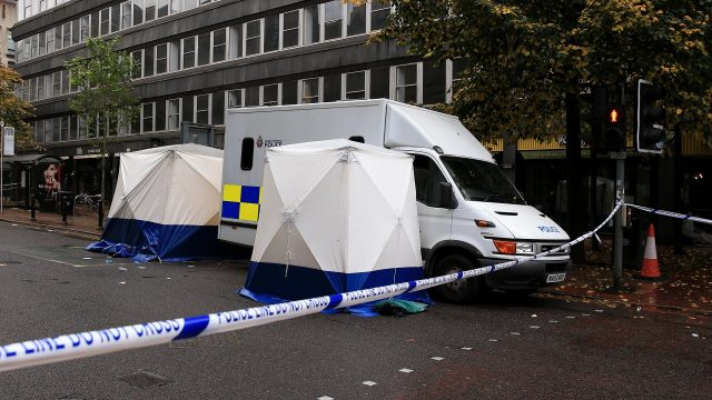 A forensic team at the scene in Manchester City Centre where a man was stabbed to death
