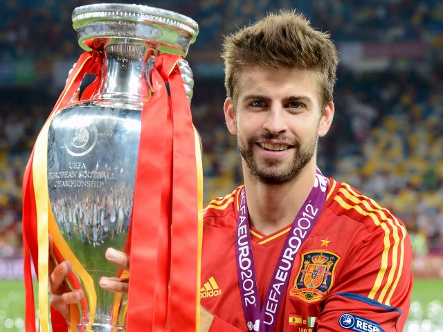 Gerard Pique poses with the Euro 2012 trophy