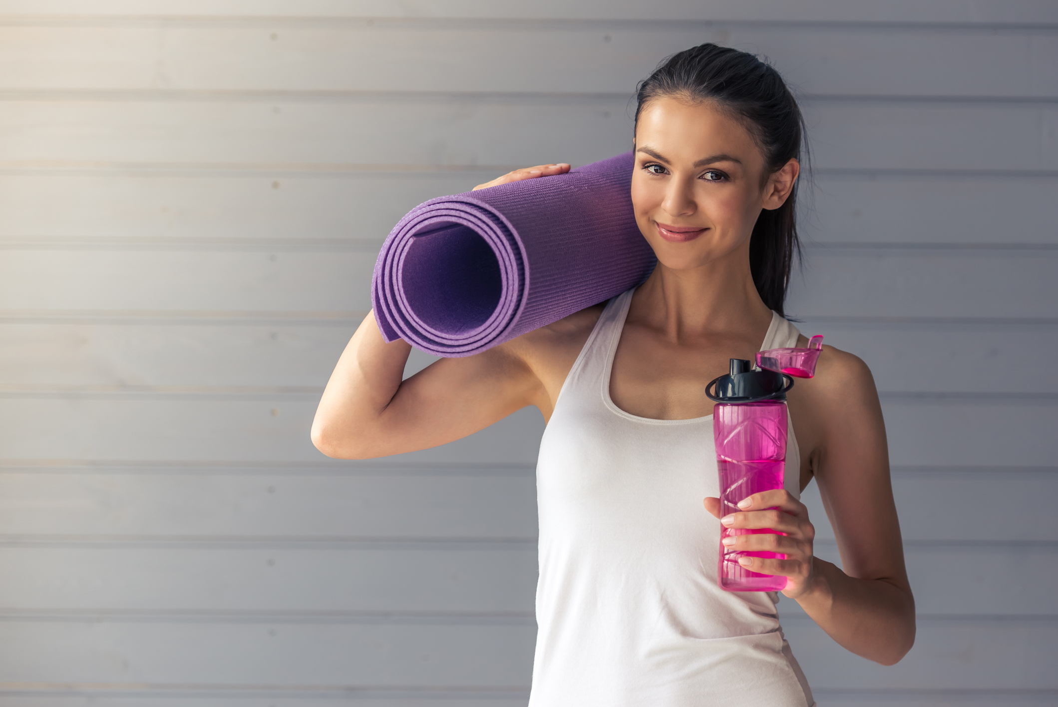 Generic photo of woman holding yoga mat and water bottle (Thinkstock/PA)