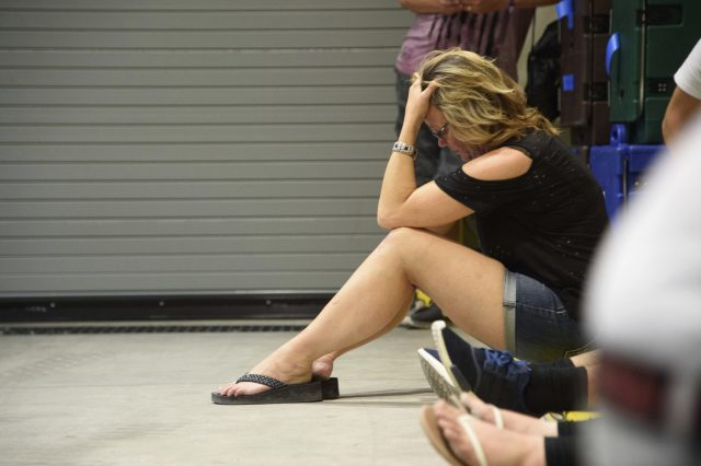 A young woman hides inside the Sands Corporation plane hangar after the shooting