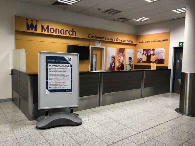 An empty Monarch customer services desk at Gatwick Airport