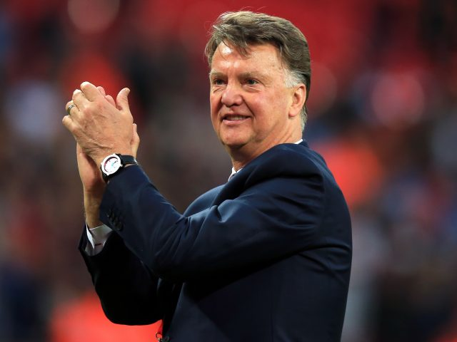 Manchester United manager Louis van Gaal acknowledges the support from the fans