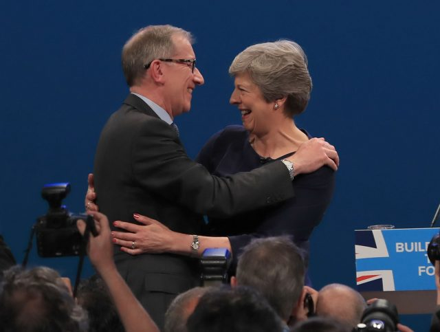 Prime Minister Theresa May is congratulated by her husband Philip