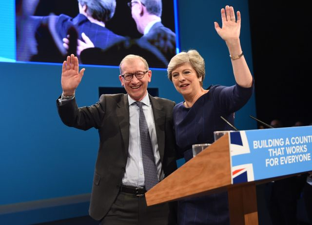 Philip and Theresa May wave to delegates after the PM's conference speech