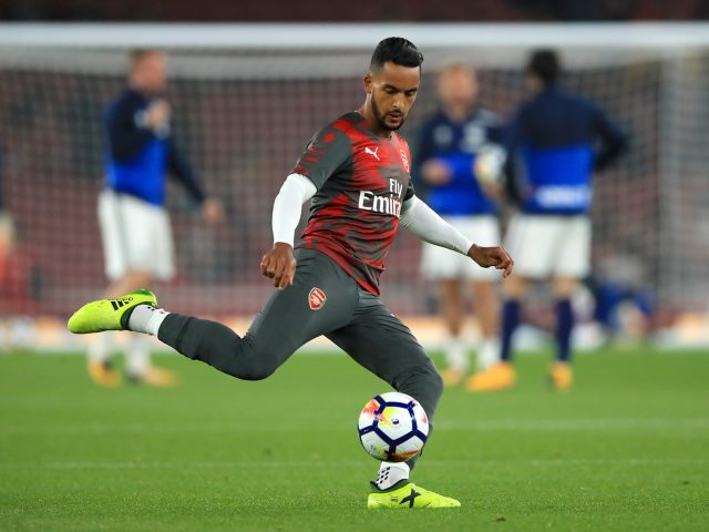 Theo Walcott warming-up against West Brom