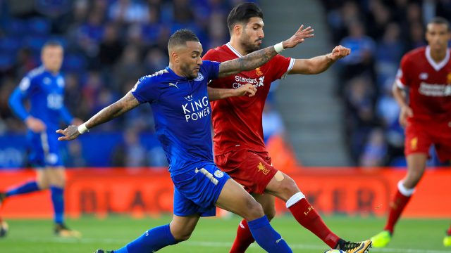 Liverpool midfielder Emre Can battles for possession with Leicester's Danny Simpson