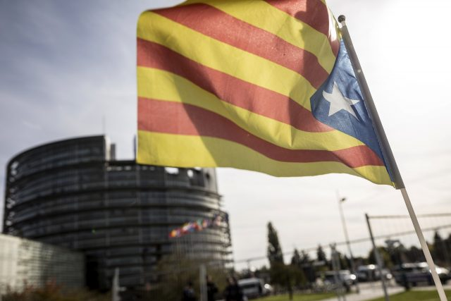 A demonstrator waves a Catalan flag