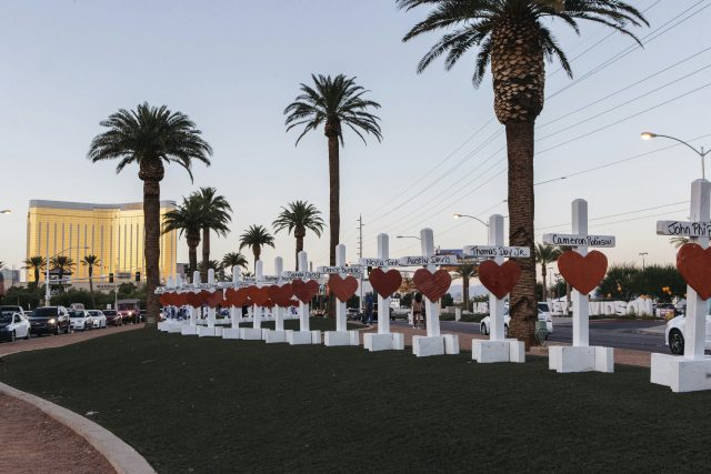 A memorial displaying 58 crosses near the Welcome To Las Vegas sign