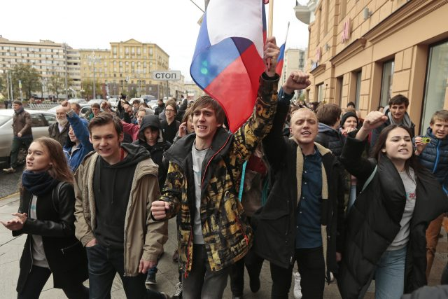 Demonstrators carry the Russian flag during a rally in Moscow