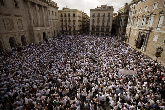 People gather during a protest in favour of talks and dialogue in Barcelona