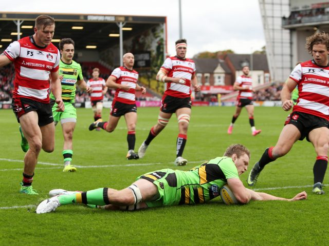 Jamie Gibson scoring a try for Northampton against Gloucester