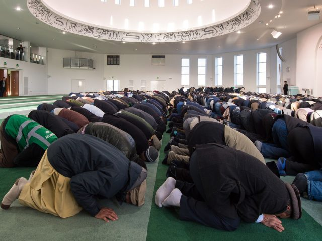 Worshippers take part in Friday prayers at the Baitful Futuh Mosque, in Morden, south London,