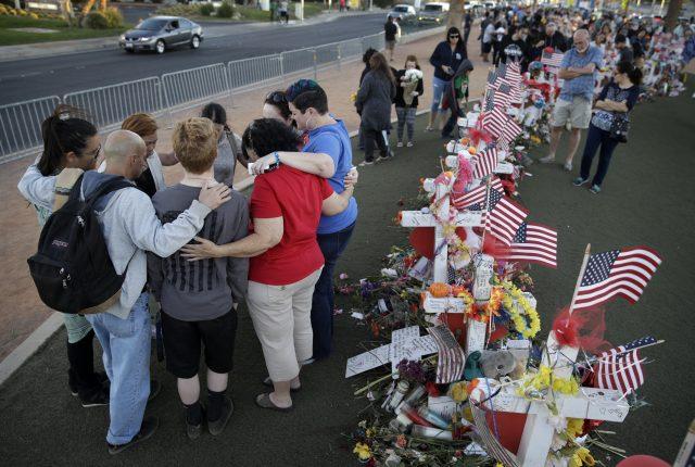People huddled in prayer