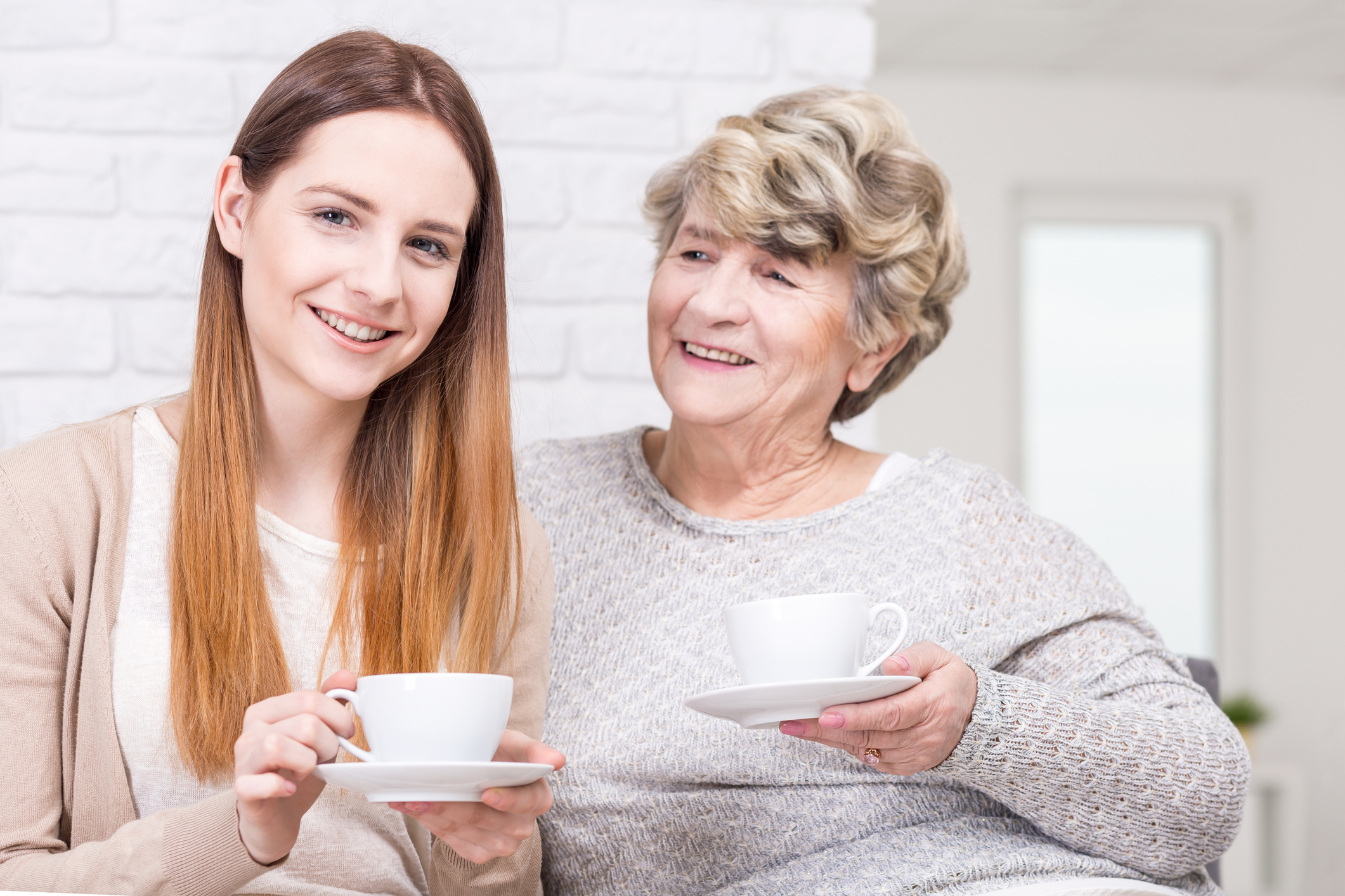 Shot of a young woman having a cup of tea with her grandma (Thinkstock/PA)